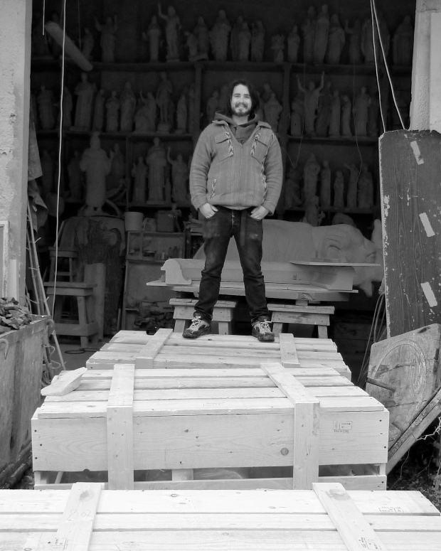 Sollai on top of his marble cases ready to go to Australia for delivery